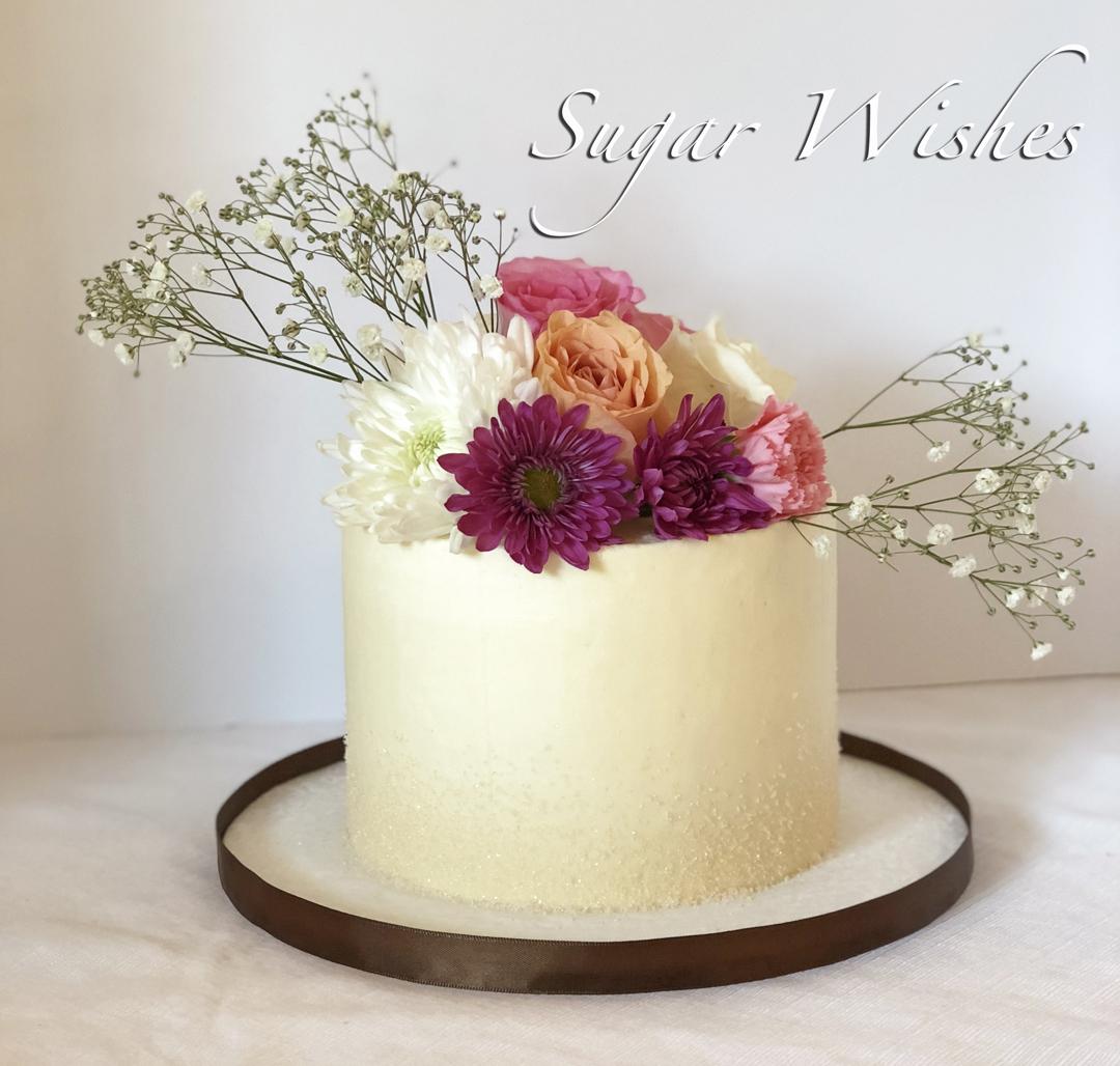 anniversary cake, birthday cake, fresh flowers, buttercream cake, sugar crystal texture, fuschia flowers, pink roses