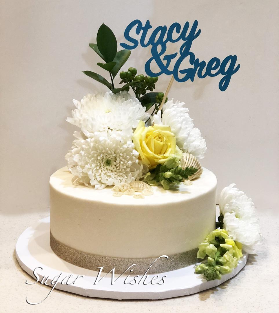 anniversary cake, buttercream cake, fresh flowers, yellow roses, white chocolate seashells, handmade sign
