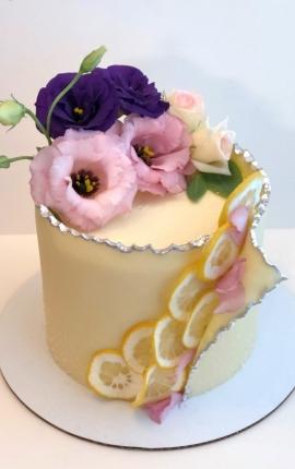 lemons, pink flowers, purple flowers, modeling chocolate, single tier cake