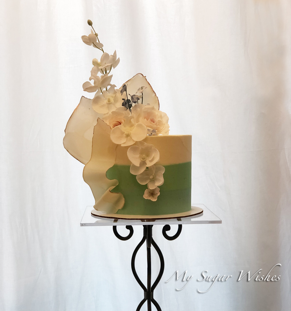 birthday cake, chocolate sculpture, orchids, buttercream cake