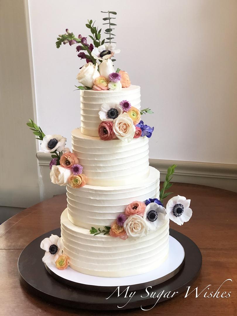 wedding cake, buttercream texture, buttercream wedding cake, fresh flowers, roses, wildflowers