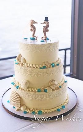 wedding cake, chocolate seashells, chocolate seahorses, cake lace, blue sugar pebbles, buttercream wedding cake