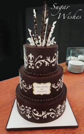 anniversary cake, wedding cake, scroll decoration, chocolate ganache, chocolate sculpture, chocolate streamers
