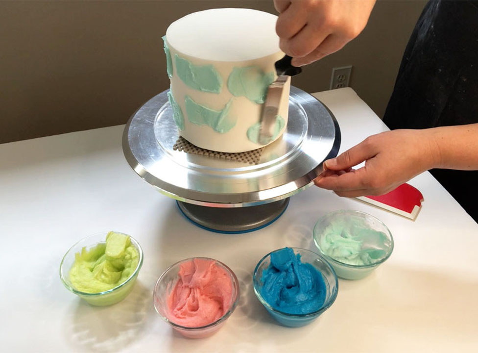 spreading one color of buttercream