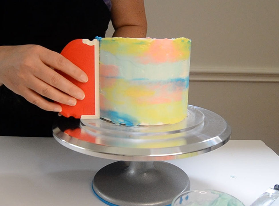 smoothing buttercream with scraper